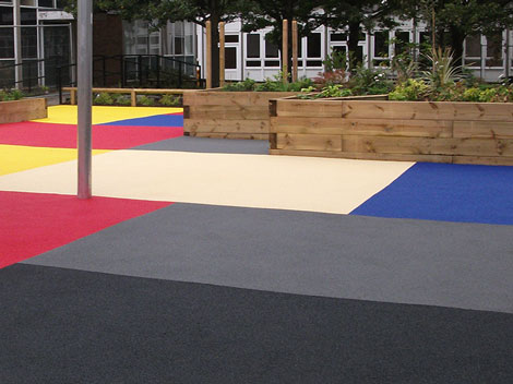 Athletic surfaces and playground covers